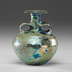 Beatrice Wood (1893-1998; USA) Double Handled Bottle Vase ca 1980 Earthenware; ht. 6, wd. 4.75, dp. 5.5 in. Artist Beato signature on base.