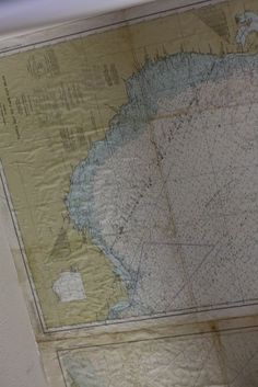 Nautical charts on ceiling