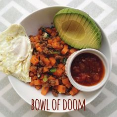 Bowl of Doom. A delicious blend of sweet potatoes and ground beef, topped with an egg, avocado, and salsa.