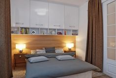 small bedroom storage ideas white upper cabinets wood panels night tables