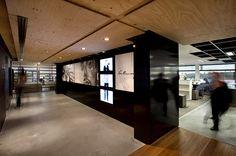 Leo Burnett Office Interiors :: Wood ceiling + black high gloss contrast + concrete floors