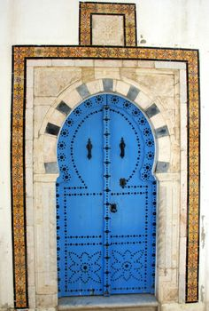 A door in Sidi Bou Said, Tunisia. The buildings in Sidi Bou Said are built in the andaluzian style, where the white and the blue are omnipresent.