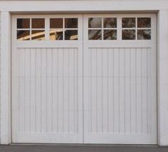 Solid Wood Garage Door Series :: Bradford - Cariage Design Wood Garage Door with Lites -  Nice doors.  Prefer the wood to vinyl and metal that's usually available .....