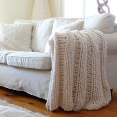 Knit with triple-stranded chunky weight yarn, this super plush ribbed blanket is an incredibly quick knit. It's the perfect project for beginning knitters who want the satisfaction of an easy finished product they can enjoy all year. Great for DIY dorm room decor!