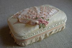 Elegantly decorated Altoid tin....this one is pretty but kind of reminds me of a coffin.....
