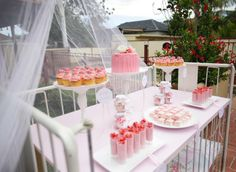 Love the idea of using a crib to display the food -- pink cupcakes and candy in crib for baby showers
