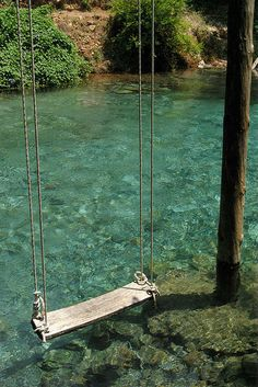 A swing- preferably suspended above crystal water