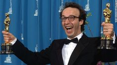 """Italian actor Roberto Benigni was unknown to American audiences before """"Life Is Beautiful,"""" but he stole the show at the 1999 Oscars ceremon..."""