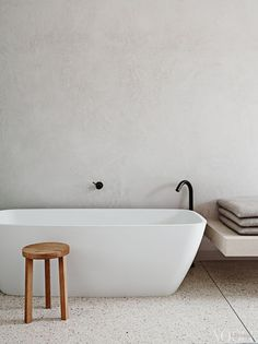 White concrete walls and light-colored terrazzo floors for a calming bathroom look. Terrazzo inspiration for home interiors and redecoration ideas. Modern Bathtub, Modern Bathroom, Small Bathroom, Bathroom Ideas, Bathroom Taps, Bathroom Fixtures, Bathroom Trends, Glitter Bathroom, Bathroom Updates
