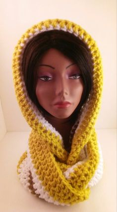 Thick, warm scarf.  Made with Bernat soft, chunky yarn, this scarf/cowl is thick and warm.  Will help ward off the winter chills and wind.  Slip the hood over your head and wrap the scarf around your neck for added warmth.  Can be worn over or under your coat.  The matching boot cuffs can be worn inside or over the top of your boots.  I just love his scarf.  It's really warm and soft.  The colors complement each other perfectly.  The boots pictured are not included with your purchase.  For…