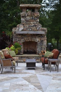 An outdoor fireplace design on your deck, patio or backyard living room instantly makes a perfect place for entertaining, creating a dramatic focal point. Rustic Outdoor Fireplaces, Outdoor Fireplace Patio, Outside Fireplace, Outdoor Fireplace Designs, Fireplace Ideas, Outdoor Rooms, Outdoor Living, Outdoor Kitchens, Outdoor Patios