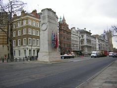 The Cenotaph war memorial stands in Whitehall. It began as a temporary structure erected for a peace parade following the end of WWI, but following an outpouring of national sentiment it was replaced by a permanent structure and designated the UKs official war memorial. Designed by Sir Edwin Lutyens, the permanent structure was built from Portland stone between 1919 and 1920 by Holland, Hannen & Cubitts, replacing Lutyens' earlier, temporary wood-and-plaster cenotaph in the same location.