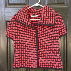 Short sleeve red checked jacket This is jacket/top is so thick and soft! It feels like cashmeres but it's actually a wool/silk/cashmere blend. I purchased this in an Upscale store in Manhattan. It's hard to tell if it's red and black or red and navy. Pockets on the inside. In excellent condition...worn once. Thanks for looking.💕 Per Se Tops Button Down Shirts