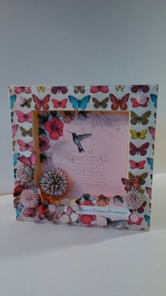 Box card using craftwork cards paradise paper, candi  and die cut flowers and sentiment.
