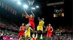 Jianghua Chen of China shoots against Patrick Mills of Australia in the second half during the men's Basketball Preliminary Round match on Day 6 of the London 2012 Olympic Games at Basketball Arena.