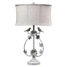 Illuminate your reading nook or bedside with this lovely table lamp, showcasing bird accents and a floral-inspired design.  Product:...