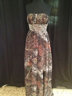 A beautiful a-line mossy oak camo dress with fully beaded waistband.