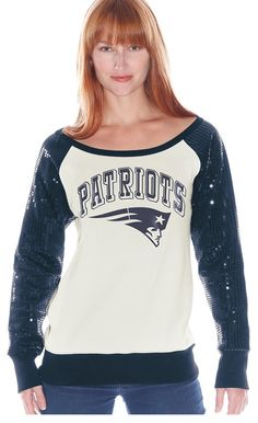 Support your team in style with this sparkling halftime pullover. Sequinned sleeves and comfy, vintage white fleece gives you a favorable fashion spread on the not-so-chic competition.