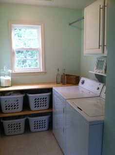 Laundry room - like the shelf top with baskets for clean clothes. Like that it is simple.