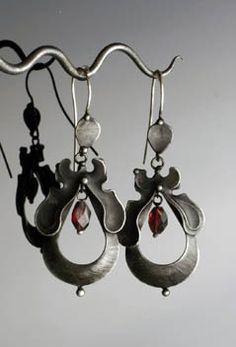 Earrings | Katherina Pflipsen Olivova.  Sterling silver, garnet and silver solder