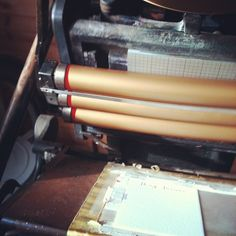 Late afternoon sun looks amazing on the gold ink-covered rollers! #letterpress