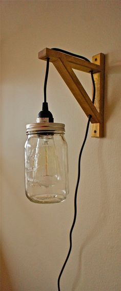 Make this from ikea bracket, but leave bulb exposed. No mason jar.
