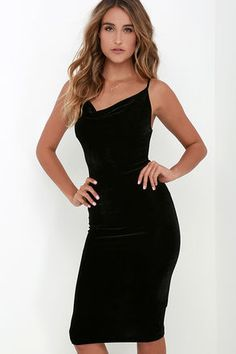 The Jazzy Belle Black Velvet Dress is worthy of a catwalk and a crowd! See for yourself as the soft, velvet knit fabric shapes a sexy cowl neckline and elastic back below rounded shoulder straps. Bodycon skirt creates a bold finish ending at a flattering midi length. Unlined. 92% Polyester, 8% Spandex. Hand Wash Cold. Made with Love in the U.S.A.