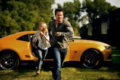 Front to back: Mark Wahlberg plays Cade Yeager and Nicola Peltz plays Tessa Yeager  in TRANSFORMERS: AGE OF EXTINCTION