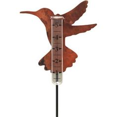 Hummingbird Rain Gauge by Gold Crest. $36.98. Measures up to 5 inches of precipitation. Made with bird and nature lovers in mind. Crafted from hammered copper alloy. Rain gauge mounted on a copper hummingbird silhouetteGraduations every 1/2 inch. Allweather copper finish. Rain gauge mounted on a copper hummingbird silhouetteGraduations every 1/2 inch. Measures up to 5 inches of precipitation. Made with bird and nature lovers in mind. Crafted from hammered copper allo...