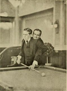 Charlie Chaplin and Douglas Fairbanks playing pool.1923