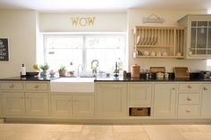 Hand crafted, hand painted English kitchen in Farrow & Ball Old White by Barnes of Ashburton. Large Belfast style sink and traditional maple plate rack. Wow!