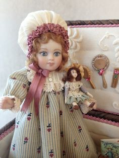 """Doll 4-1/2"""" all porcelain in basket by Sandra Burgess"""