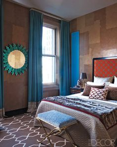 Kedigian designed the guest bedroom's carpet and headboard, which  is upholstered in a Dedar cotton; the walls are Venetian plaster, and  the silk curtains and mirror hung in the apartment when Drake lived there.   - ELLEDecor.com