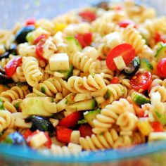 Cold Pasta Salad.  As pasta salads go, this one has the fairly common ingredients of sweet peppers, cucumber, onions and tomato.  What makes this salad exceptional is the wonderful tomato dressing which is spiced up with red pepper flakes and has the bite of lots of fresh basil.