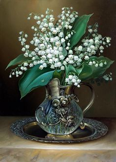 DIY Diamond Painting.  Lily of the Valley, a floral in a vase.  Square plastic bits that are attached to an adhesive canvas by assigned color. Pieces are about