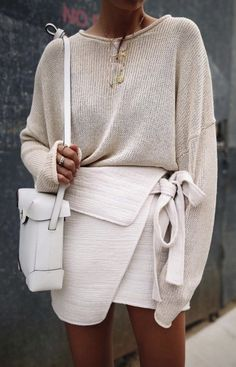 off white and being outfit. Love the side tie on this skirt and the slouchy sweater. Such a good outfit for spring! #womensfashion #womenswear #springfashion #skirtoutfits