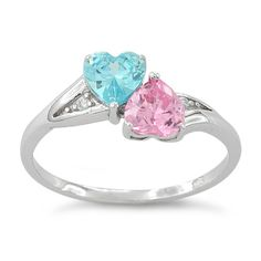 sterling silver ring with two heart shaped stones in Pink & Blue Topaz!  This ring is a perfect way to fondly remember your pregnancy or infant loss!  This ring has two heart shaped stones one blue and one pink as well as ascent clear cubic zirconia  Only the Sizes Listed are available!  Due to differences in computer monitors colors may vary slightly
