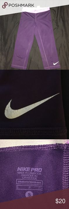 Nike pro crops Beautiful dark purple with light purple band. Great condition. Only flaw is cracking on Nike sign as shown. Still have a lot of life in them! Nike Pants Track Pants & Joggers
