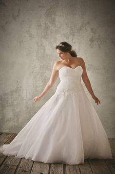 Strapless tulle and lace plus size ball gown at @DavidsBridal