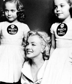 Marilyn and twins Lindy and Sandy Sue Solomon at the March of Dimes Fashion Show at the Waldorf Astoria, January 28th 1958.