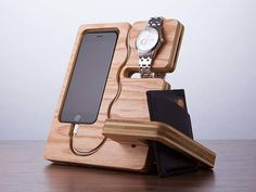 The wood docking station doubles as a desk organizer phone flip . desk phone stand and file mail organizer