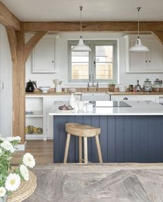 Coastal cottage style kitchen with an accent painted island