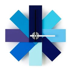 Watch Me Wall Clock - Blue - This simplistic and figurative wall clock is inspired by a colour swatch that folds out like a fan. Each individual steel plate is finished in different shades of blue to create a wonderful and aesthetically pleasing design. The Watch Me Wall Clock Blue makes a unique and stylish gift for him and never fails to impress visitors with its eye-catching look. This colour swatch steel clock is also available in pink, as seen below! Watch Me Wall Clock - Blue Spe...