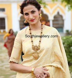 Shilpa Reddy in an antique gold nakshi balls and rudraksh mala with temple nakshi pendant paired with gold jhumkas.