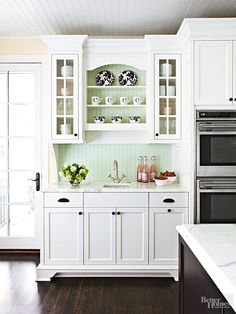 Line the back of shelves or a backsplash with beaded board to add cottage-style texture to your kitchen. Paint the beaded board a fun color that matches the rest of your kitchen, and be sure to finish it with a waterproof sealant if you are installing it behind or around a sink.