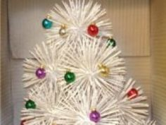 Tooth Pick Christmas Tree.  This looks a lot like the one we had growing up - ours was a little more symetrical and we had a large styrofoam base so we could also spray paint with snow and add a little Christmas scene if we wanted.  Fond memories!