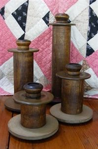 Bobbins; display some in the shelf above the scrap book supplies.