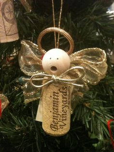 Wine cork angel ornament pinned this because I like the way the hole in the bead is lined up to be the mouth.....need to remember this
