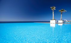 So blue! A stunning infinity pool at Vidamar resorts, Madeira, Portugal. European Holidays, Luxury Holidays, Hotel Portugal, Resorts, Amazing Swimming Pools, Half Board, Funchal, Best Hotels, Beautiful Places