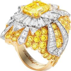 """One-of-a-kind """"Beaute Celeste"""" ring from the """"Peau d'Âne"""" collection featuring 4.05-carat emerald-cut fancy vivid yellow diamond and white and yellow diamonds set in 18K white and yellow gold."""